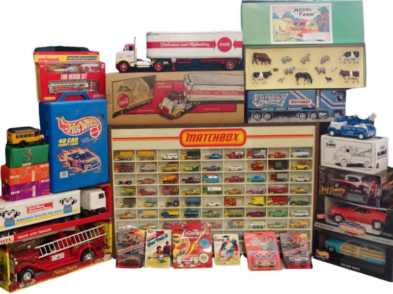 Groupong of collectible toys such as Hot Wheels, Matchbox, Corgi, Winross and more.