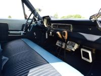 vintage plymouth police car front seat